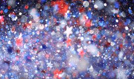 Red, white, and blue sparkling glitter scattered with shiny stars confetti. 4th of July celebration background