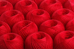 Background red yarn. Texture of colored yarn skeins royalty free stock photography