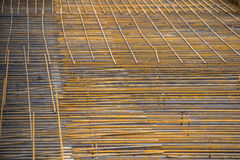 Background of reinforced steel bars Stock Photos