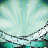 Background with retro filmstrip. And stars Royalty Free Stock Photo