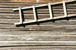Background retro log house wall wooden ladder hang Stock Photography