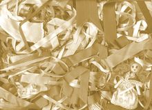 Background ribbon. A tangle of ribbons and a little doll for background, scrapbook, wrapping paper, packaging Stock Photo