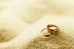 Wedding Rings in the Sand. Background rings engagement close up design photography carat Royalty Free Stock Image