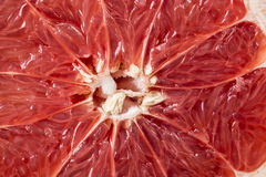 Background of ripe grapefruit Slice on black, fresh fruit texture closeup Stock Photo