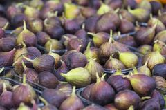 Background of ripe juicy figs on the market stalls Stock Photo