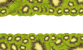 Background of ripe kiwi. Green background of ripe kiwi fruit with a white stripe in the middle Stock Photography
