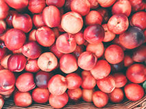 Background with ripe red peaches. Stock Photo