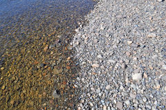 Background of river pebbles. Stock Images