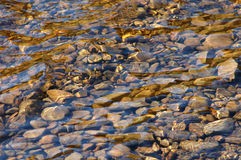 Background of river stones. Background image of some smooth stones in a river stock photo