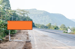 Background of road sign on blue sky mountain Stock Image