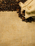 Background of the roasted coffee beans and burlap Stock Photography