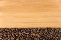 Background from roasted coffee beans on desk. Background from roasted coffee beans on wooden desk royalty free stock image