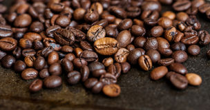 Background roasted coffee beans. Coffee beans, fried coffee, the grains lie on the table Stock Photos