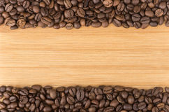 Background from roasted coffee beans on wood Stock Photography