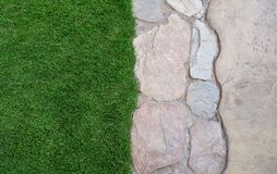 Background of rock on grass. Background with rock on grass in the garden walk Royalty Free Stock Photography