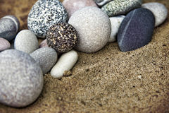 Background rocks and sand closeup Stock Photos