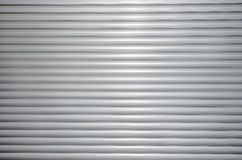 Background with roller shutters. Of aluminum Royalty Free Stock Photo