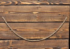 Background, rope on a wooden background, boards, texture Stock Images