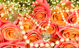 Background of rose and beads Royalty Free Stock Images