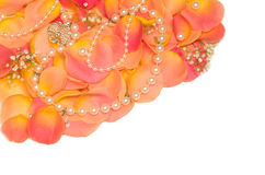 background of rose and beads Royalty Free Stock Photo