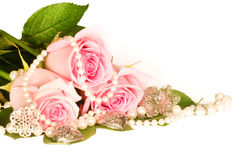 Background of rose and beads Stock Photography