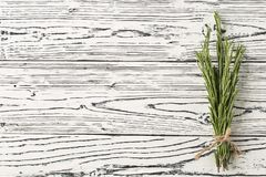 Background rosemary on a wooden table. Spices and herbs. royalty free stock photo