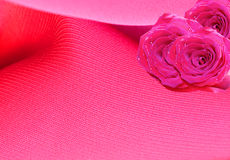 Background with roses. Bouquet of roses on pink silk Royalty Free Stock Photography