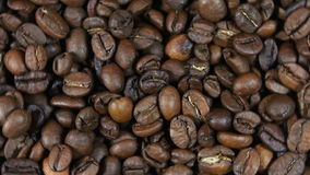 Background of the rotating coffee beans stock footage