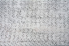 Background rough brick wall painted with white paint Stock Images