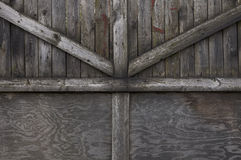 Background with rough wooden boards. Old massive wooden gate made of rough wooden boards royalty free stock image