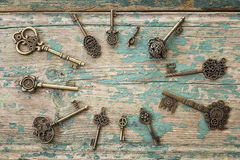 Background with round frame of antique keys on old painted woode Stock Image