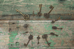 Background with round frame of antique keys on old painted woode Royalty Free Stock Photo