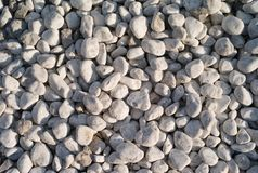 A Background of Round, Natural, Grey Stones royalty free stock photo