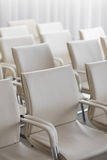 Background of row of white seats. Empty hairs in the conference hall.  Royalty Free Stock Images