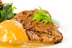 Background of Rump steak with mashed potatoes Stock Photography