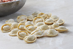 Background from russian crude pelmeni. Traditional Russian dish Royalty Free Stock Image