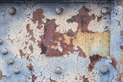Background of rusted metal with peeling paint, nuts and bolts, copy space stock photos