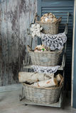 Background rustic veranda with a shelf with baskets and angels Royalty Free Stock Image