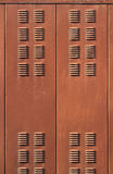 Background with rusty brown metal ventilation grille doors.  Stock Photos