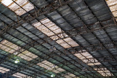 Background of a rusty roof with skylights. Stock Photos