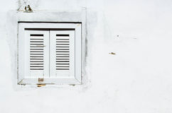 Background: Rusty window on the white wall Stock Images