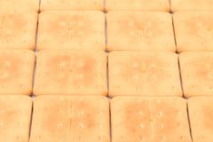 Background of saltine soda crackers. Stock Photography