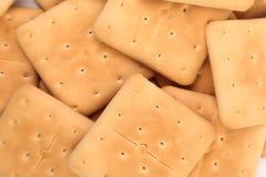 Background of saltine soda crackers. Royalty Free Stock Photos