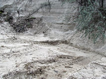 Background of the Sand quarry. A wall of white sand and traces of Machines that came to collect its Stock Photography