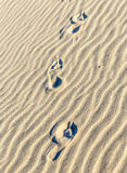 Background of sand ripples at the beach with footsteps Royalty Free Stock Photography