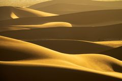 Background with of sandy dunes in desert stock photos