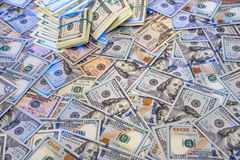 Background from scattered dollar banknotes Stock Photos