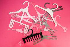 Background of scattered hangers for clothes on a pink royalty free stock image