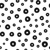 Background with scattered round elements painted with a rough brush. Seamless pattern. Stock Photo