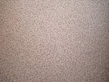 Background of scattered sand fine gravel. Texture of a stone surface, closeup. Golden crumb Stock Images